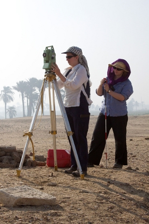 Hannah Pethen and Sarah Doherty surveying with a total station